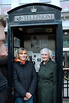 Two women in a telephone box after the funeral cortege had passed Ludgate Circus during the funeral of Margaret Thatcher, London, 17 April 2013.<br />