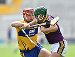 David Reidy of Clare in action against Diarmuid O Keeffe of Wexford during their All-Ireland quarter final at Pairc Ui Chaoimh. Photograph by John Kelly.