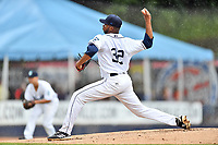 Asheville Tourists starting pitcher Frederis Parra (32) delivers a pitch during a game against the Augusta GreenJackets at McCormick Field on August 19, 2018 in Asheville, North Carolina. The Tourists defeated the GreenJackets 6-3. (Tony Farlow/Four Seam Images)