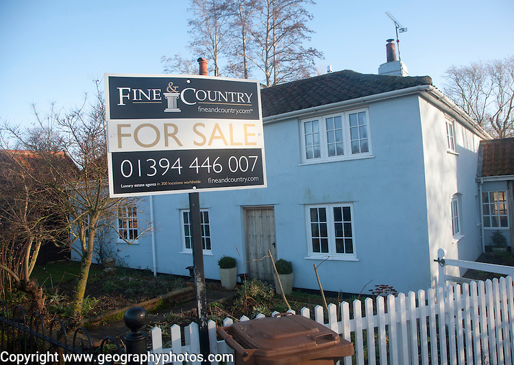Fine and Country estate agent for sale sign outside detached rural house, Suffolk, England