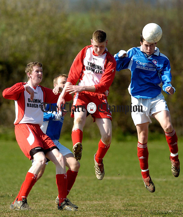 Bunrattys Christy Griffin jumps with Newmarkets Ronan McCormack in their Youths Cup match at Ballycar.Pic Arthur Ellis.