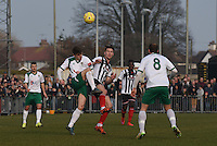 Doug Tuck of Bognor Regis Town is challenged by Craig Clay of Grimsby Town during the FA Trophy Semi Final first leg match between Bognor Regis and Grimsby Town at Nyewood Lane, Bognor Regis, England on 12 March 2016. Photo by Paul Paxford/PRiME Media Images.