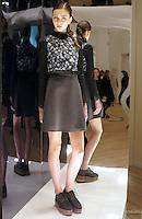 Model in Look 20: Black Lasered Neoprene Top, Bohemian Rhapsody Top, Charcol Solid Suiting Skirt