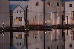 Boathouse reflections in rows along the waterfront at Everett Marina
