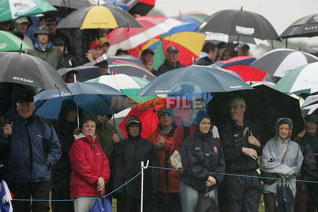 Part of the large crowds sheltering as best they can fro the elements on the 1st hole during the first round of the Smurfit Kappa European Open at The K Club, Strffan,Co.Kildare, Ireland 5th July 2007 (Photo by Eoin Clarke/NEWSFILE)