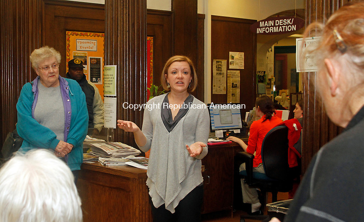 Torrington, CT- 30 October 103014MK04 Jessica Hodorski, Program Coordinator and Teen Services, (right) lead a group of about fifteen people on a haunted library tour, as Shirley Gay (left) looks on Thursday evening at the Torrington Library. Hodorski guided the guests through the stacks while describing legends and lore of literature's scary stories as well as ghost stories from happenings in the building. Michael Kabelka / Republican-American