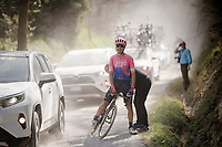 Alberto Bettiol (ITA/EF Education First) cramping out mid-race & needing an impromptu roadside massage from a bystander on the white dust roads of Tuscany<br /> <br /> 13th Strade Bianche 2019 (1.UWT)<br /> One day race from Siena to Siena (184km)<br /> <br /> ©kramon