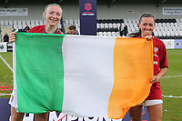 Louise Quinn and Katie McCabe of Arsenal Women with the Irish flag after Arsenal Women vs Manchester City Women, FA Women's Super League Football at Meadow Park on 11th May 2019