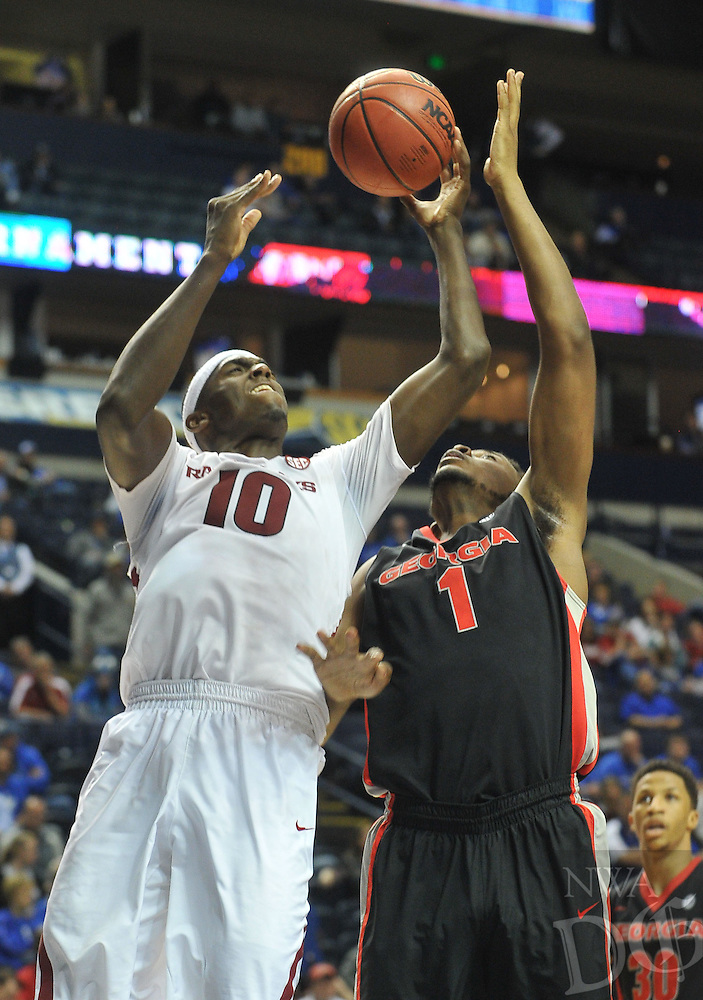 NWA Democrat-Gazette/Michael Woods --03/14/2015--w@NWAMICHAELW... University of Arkansas forward Bobby Portis tries to drive past Georgia defender Yante Maten during the second half of the Razorbacks 60-49 win in Saturdays game against the Georgia Bulldogs at the 2015 SEC basketball tournament at Bridgestone Arena in Nashville.