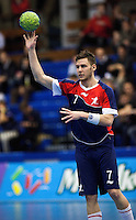 02 NOV 2011 - LONDON, GBR - Britain's Chris Mohr (#07 - blue and red) passes during the Men's 2013 World Handball Championship qualification match against Israel at the National Sports Centre at Crystal Palace (PHOTO (C) NIGEL FARROW)
