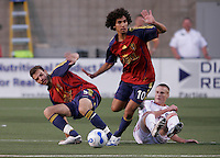 Chicago Fire midfielder Brian Plotkin (16) and Real Salt Lake defender Daniel Torres (5) recover from a collision as midfielder Mehdi Ballouchy (10) dribbles through. Real Salt Lake defeated the Chicago Fire 3-1 at Rice Eccles Stadium, Salt Lake City, Utah, June 3, 2006.
