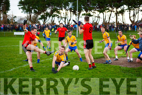 Stephen O'Sullivan Glenbeigh/Glencar  last minute shot is blocked by Nathan Breen Beaufort during the Mid Kerry final in Killorglin on Sunday