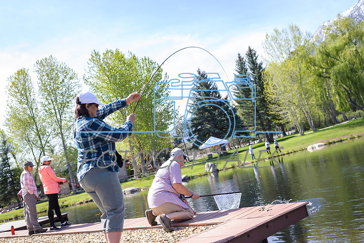 Lisa Selcer learns to fly fish with the help of her River Buddy Gretchen Montgomery during the Casting for Recovery fishing clinic at Bently Ranch in Gardnerville, Nev. May 4, 2018.<br /> Photo by Candice Vivien/Nevada Momentum