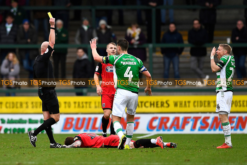 Referee Charles Breakspear   gives a second yellow before giving a red card to Craig Alcock of Yeovil Town during Yeovil Town vs Grimsby Town, Sky Bet EFL League 2 Football at Huish Park on 9th February 2019