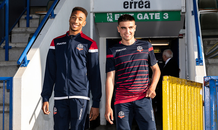Bolton Wanderers' D'Neal Richards (left) and Finlay Hurford-Lockett go out to inspect the pitch before the match<br /> <br /> Photographer Andrew Kearns/CameraSport<br /> <br /> The Carabao Cup First Round - Rochdale v Bolton Wanderers - Tuesday 13th August 2019 - Spotland Stadium - Rochdale<br />  <br /> World Copyright © 2019 CameraSport. All rights reserved. 43 Linden Ave. Countesthorpe. Leicester. England. LE8 5PG - Tel: +44 (0) 116 277 4147 - admin@camerasport.com - www.camerasport.com