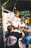 In the Johnson Space Center's (JSC) Weightless Environment Training Facility (WET-F), astronaut Jerry M. Linger, STS-81 mission specialist, prepares for an underwater simulation of a contingency Extravehicular Activity (EVA) on September 13, 1996.  Linger, attired in a training version of his space suit, will utilize the nearby 25-foot deep pool, in which he will be able to achieve a neutrally buoyant state.<br /> Credit: NASA via CNP