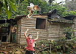 A boy plays with a turkey on the family's small farm in the mountains of Topes de Collantes mountains, between Trinidad and Cienfuegos, Cuba