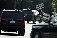 United States President Donald J. Trump's motorcade passes by a protestor outside Trump National Golf Club in Sterling, Virginia on Saturday, June 8, 2019. Photo Credit: Yuri Gripas/CNP/AdMedia