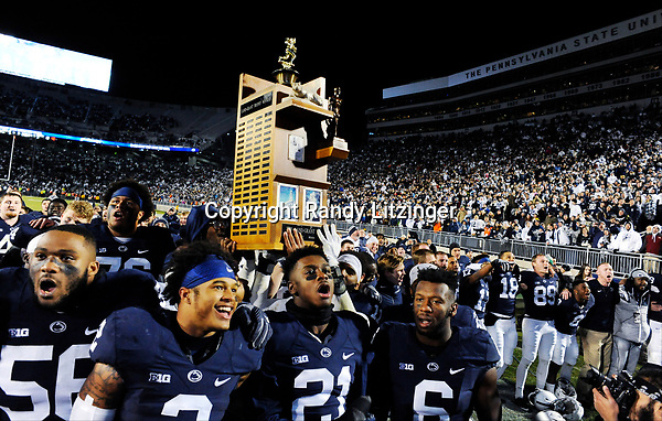STATE COLLEGE, PA - NOVEMBER 26:  Penn State's Tyrell Chavis (56), Sterling Jenkins (76), S Marcus Allen (2), CB Amani Oruwariye (21), and S Malik Golden (6) celebrates with the Land Grant Land-Grant Trophy after the game. The Penn State Nittany Lions defeated the Michigan State Spartans 45-12 to win the Big Ten East Division on November 26, 2016 at Beaver Stadium in State College, PA. (Photo by Randy Litzinger/Icon Sportswire)
