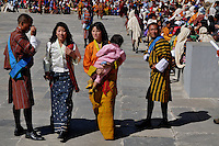 "Young bhutanese ladies in their national dress at Thimpu Tshechu. The Tshechu is a festival honouring Guru Padmasambhava, ""one who was born from a lotus flower."" This Indian saint contributed enormously to the diffusion of Tantric Buddhism in the Himalayan regions of Tibet, Nepal, Bhutan etc. around 800 AD. He is the founder of the Nyingmapa, the ""old school"" of Lamaism which still has numerous followers. The biography of Guru is highlighted by 12 episodes of the model of the Buddha Shakyamuni's life. Each episode is commemorated around the year on the 10th day of the month by ""the Tschechu"". The dates and the duration of the festivals vary from one district to another but they always take place on or around the 10th day of the month according to the Bhutanese calendar. During Tshechus, the dances are performed by monks as well as by laymen. The Tshechu is a religious festival and by attending it, it is believed one gains merits. It is also a yearly social gathering where the people, dressed in all their finery, come together to rejoice. Arindam Mukherjee."
