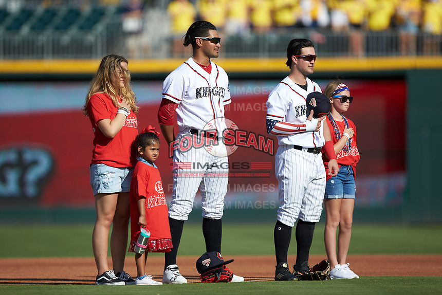 (L-R) Charlotte Knights infiedlers Jose Rondon (6) and Eddy Alvarez (10) are joined by young fans on the field for the National Anthem prior to the game against the Durham Bulls at BB&T BallPark on July 4, 2018 in Charlotte, North Carolina. The Knights defeated the Bulls 4-2.  (Brian Westerholt/Four Seam Images)