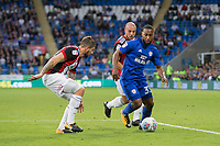 Junior Hoilett of Cardiff City attempts to get past Kieron Freeman of Sheffield United during the Sky Bet Championship match between Cardiff City and Sheffield United at Cardiff City Stadium, Cardiff, Wales on 15 August 2017. Photo by Mark  Hawkins / PRiME Media Images.