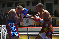 Alex Bishop (red shorts) defeats Sergio Gugliotta during a Boxing Show at York Hall on 30th November 2018