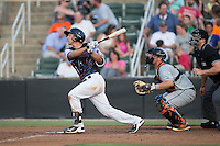 Seby Zavala (21) of the Kannapolis Intimidators follows through on his swing against the Delmarva Shorebirds at Kannapolis Intimidators Stadium on June 25, 2016 in Kannapolis, North Carolina.  The Intimidators defeated the Shorebirds 2-1.  (Brian Westerholt/Four Seam Images)