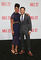 "WESTWOOD, CA - AUGUST 9: Nemuna Ceesay, Carlo Alban, at Premiere Of STX Films' ""Mile 22"" at The Regency Village Theatre in Westwood, California on August 9, 2018. Credit: Faye Sadou/MediaPunch"