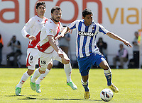 Rayo Vallecano's Javi Fuego (c) and Jose Carlos Fernandez (l) and Real Sociedad's Carlos Vela during La Liga match.April 14,2013. (ALTERPHOTOS/Acero)
