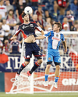 New England Revolution defender Stephen McCarthy (26) heads the ball. In a Major League Soccer (MLS) match, the New England Revolution tied Philadelphia Union, 0-0, at Gillette Stadium on September 1, 2012.