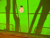Switzerland. Canton Ticino. Lugano. Sunset on the indoor tennis clay court Club Lido Lugano. Clock face showing 4.30 PM. 28.10.10 © 2010 Didier Ruef..
