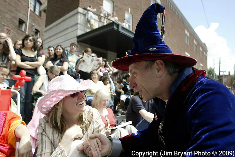 Merlin the Wizard, greets parade watcher, Diane Ibsen in the 21st annual Summer Solstice Parade held Saturday, June 20, 2009 in Seattle, Wa. The parade was held Saturday, bringing out painted and naked bicyclists, bands, belly dancers and floats. (Jim Bryant Photo © 2009).. .