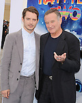"HOLLYWOOD, CA - NOVEMBER 13: Elijah Wood and Robin Williams attend the ""Happy Feet Two"" Los Angeles premiere held at the Grauman's Chinese Theatre on November 13, 2011 in Hollywood, California."