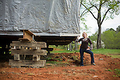 Nancy Murray, founder and CEO of Builders of Hope in front of salvaged and re-located home in South-East Raleigh that will have a foundation built underneath it.