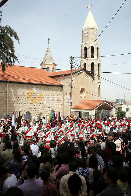 An Orthodox Christians take part in the celebrations in the West Bank town of Beit Sahour near Bethlehem on 03 April 2010. Orthodox Christians believe a holy fire appears spontaneously from Jesus' tomb on the day before the Orthodox Easter. The fire is seen as a message that Jesus has not forgotten his followers. Photo by Najeh Hashlamoun