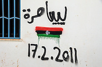 Graffiti on a wall showing the Libyan flag and 17.2.2011. On 17 February 2011 Libya saw the beginnings of a revolution against the 41 year regime of Col Muammar Gaddafi.