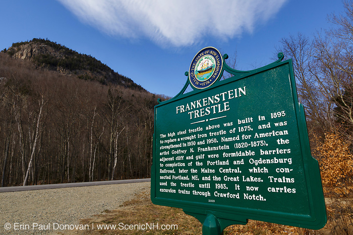 Frankenstein Trestle sign along Route 302 in Crawford Notch State Park in Hart's Location, New Hampshire. This trestle is located along the old Maine Central Railroad, which is in the background out of view below the cliff. Since 1995 the Conway Scenic Railroad, which provides passenger excursion trains has been using the track.