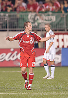 Chad Barrett (19) celebrates a goal with the crowd at BMO Field against the New England Revolution. .The game ended in a 1-1 draw.