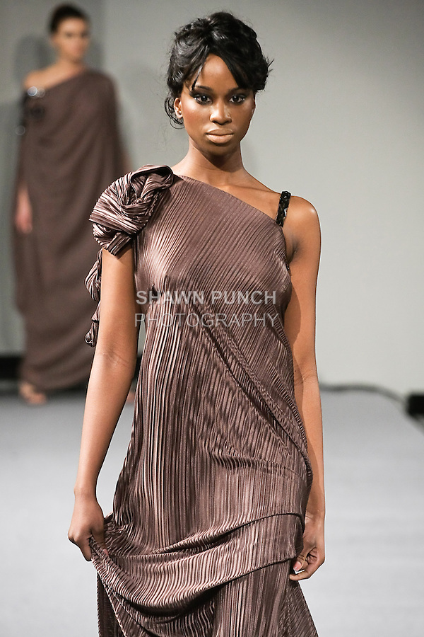 Model walks the runway in an outfit from the Patuna Bushyhead Fall 2012 collection, during Couture Fashion Week New York, February 18, 2012.