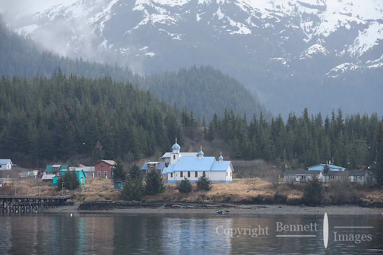 The misty Chugach Mountains loom over the Russian Orthodox Church in the Native village of Tatitlek, in Prince William Sound, Southcentral Alaska on a spring day in early May.