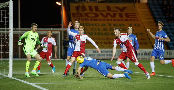 Kilmarnock's Gary Dicker clears from David Bates and Danny Wilson