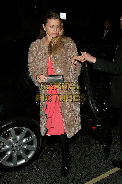 LAURA BAILEY.The Vogue Pre BAFTA Party at Cecconis, Mayfair, London, England..February 8th, 2008 .full length brown fur beige pink dress black tights silver clutch bag purse .CAP/AH.©Adam Houghton/Capital Pictures