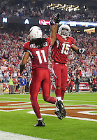 Dec 6, 2009; Glendale, AZ, USA; Arizona Cardinals wide receiver (11) Larry Fitzgerald is congratulated by teammate (15) Steve Breaston against the Minnesota Vikings at University of Phoenix Stadium. The Cardinals defeated the Vikings 30-17. Mandatory Credit: Mark J. Rebilas-