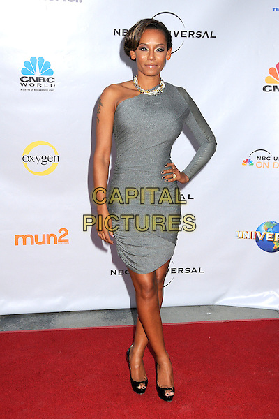 "MELANIE BROWN (MEL B).The Cable Show 2010 ""An Evening with NBC Universal"" held at Universal Studios Hollywood, Universal City, California, USA..May 12th, 2010.full length grey gray one shoulder sleeve dress black peep toe platform shoes christian louboutin hand on hip .CAP/ADM/BP.©Byron Purvis/AdMedia/Capital Pictures."