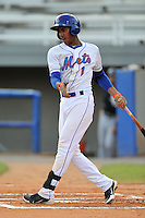 Kingsport Mets shortstop Amed Rosario #1 swings at a pitch during a game against the Bristol White Sox at Hunter Wright Stadium on August 15, 2013 in Kingsport, Tennessee. The White Sox won the game 4-2. (Tony Farlow/Four Seam Images)