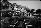 Railroad track with car alongside track and shed to left side. Could be in area of Otowi crossing.<br /> D&amp;RGW  Otowi ?, NM