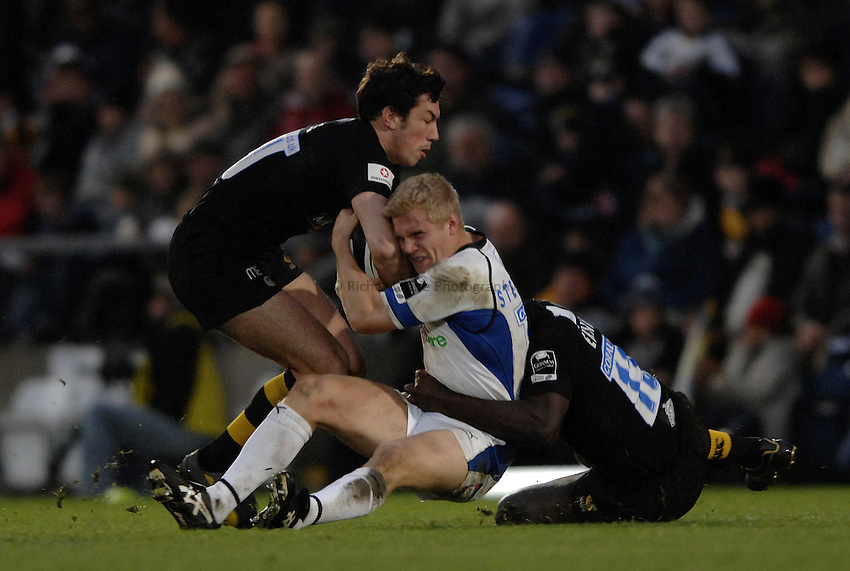 Photo: Richard Lane..London Wasps v Bath Rugby. Guinness Premiership. 12/11/2006. .Bath's Michael Stephenson is tackled by Wasps' Tom Voyce.