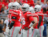 Ohio State Buckeyes quarterback J.T. Barrett (16) and offensive lineman Jamarco Jones (74) look to the sideline for the play call during the NCAA football game against the Rutgers Scarlet Knights at Ohio Stadium in Columbus on Oct. 1, 2016. Ohio State won 58-0. (Adam Cairns / The Columbus Dispatch)