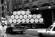 "New York City, NY, June 20th, 1971. The New York Times building 229 west 43rd street. The main entrance with the frontispiece where it is written ""All the news that's fit to print"" . Also the truck with the rolls of paper to print The New York Times."